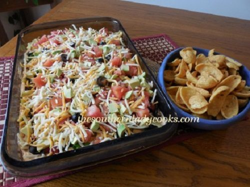 this layered taco dip is so versatile you can add your favorite layers ...
